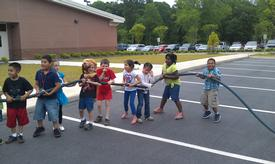 Letter land day @ Murray (students with fire hose)
