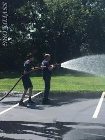 Chief Greene and Explorer J. Ramsey flowing water.