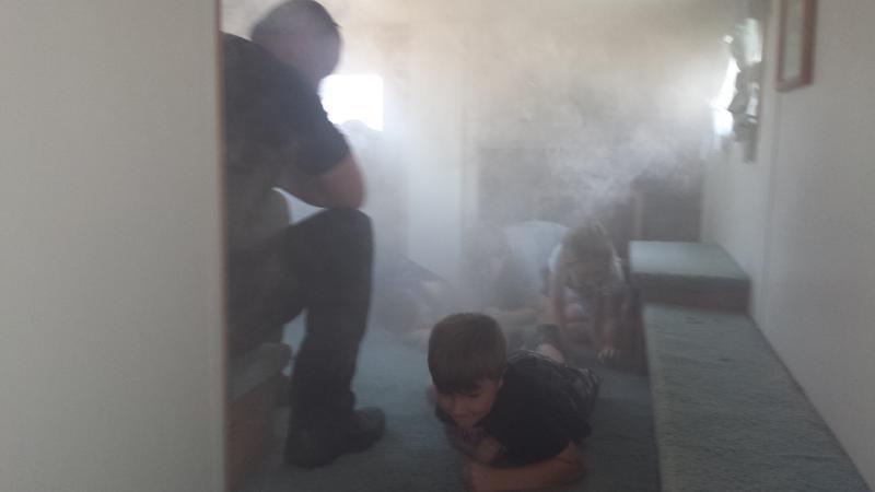 Crawl low under smoke!